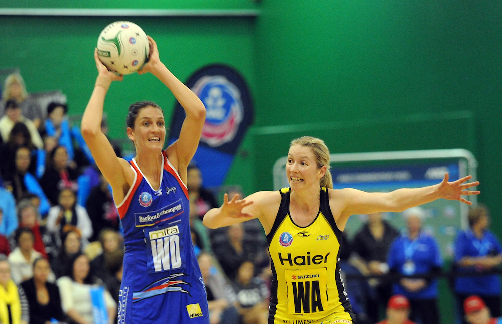 Mystics' Anna Harrison, left, plays in front of Pulse's Camilla Lees in the ANZ Championship netball, Arena Manawatu, Palmerston North, New Zealand, Sunday, May 18, 2014. Credit:SNPA / Ross Setford
