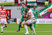 Celtic FC Midfielder Kris Commons and Hamilton Academical Defender Lucas Tagliapietra collide during the Ladbrokes Scottish Premiership match between Hamilton Academical FC and Celtic at New Douglas Park, Hamilton, Scotland on 4 October 2015. Photo by Craig McAllister.