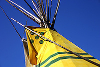 Yellow Plains Indian Tipi contrasts with Blue Sky
