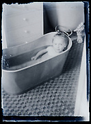 little child taking a bath in a sink tub France 1920s