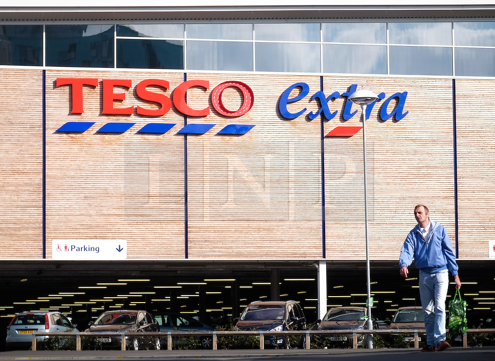 © Licensed to London News Pictures. 05/10/2016. Portsmouth, Hampshire, UK.  A man walking out of a Tesco Extra in Portsmouth this morning. Tesco PLC, Britain's largest supermarket chain has announced that like-for-like sales had grown in the first half of its financial year. The results come following increased competition in the market from budget supermarkets such as Aldi & Lidl. Photo credit: Rob Arnold/LNP