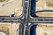 Nederland, Zuid-Holland, Rotterdam, 18-02-2015; kruising Coloradoweg en Europaweg (N15) op grens Eerste en Tweede Maasvlakte (MV2). <br /> Maasvlakte 1 en 2, extension of the Port of Rotterdam<br /> luchtfoto (toeslag op standard tarieven);<br /> aerial photo (additional fee required);<br /> copyright foto/photo Siebe Swart