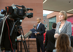 © Licensed to London News Pictures. 23/09/2014. Manchester, UK. Chuka Umunna and Harriet Harmen give early morning television interviews. Labour Party Conference 2014 at the Manchester Convention Centre today 23 September 2014. Photo credit : Stephen Simpson/LNP