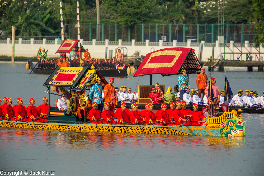 06 NOVEMBER 2012 - BANGKOK, THAILAND:  The barge Seua Thayan Chon Barge and other royal barges participate in the final dress rehearsal for the Royal Barge Process on the Chao Phraya River in Bangkok. Thailand's Royal Barge Procession has both religious and royal significance. The tradition is nearly 700 years old. The Royal Barge Procession takes place rarely, typically coinciding with only the most important cultural and religious events. During the reign of King Bhumibol Adulyadej, spanning over 60 years, the Procession has only occurred 16 times. The Royal Barge Procession consists of 52 barges: 51 historical Barges, and the Royal Barge, the Narai Song Suban, which King Rama IX built in 1994. It is the only Barge built during King Bhumibol's reign. These barges are manned by 2,082 oarsmen. The Procession proceeds down the Chao Phraya River, from the Wasukri Royal Landing Place in Bangkok, passes the Grand Palace complex and ends at Wat Arun. Tuesday's dress rehearsal was the final practice for the 2012 Royal Barge Procession, which takes place November 9.    PHOTO BY JACK KURTZ
