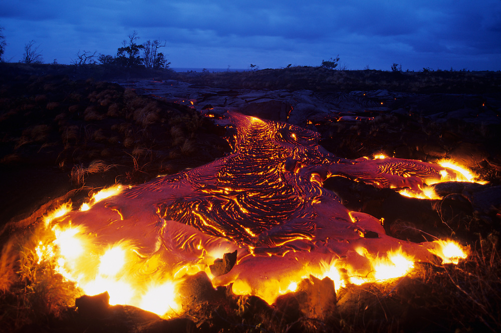 USA, Hawaii, Volcanoes National Park,  Molten lava flows across coastal plain during Kilauea eruption at dusk