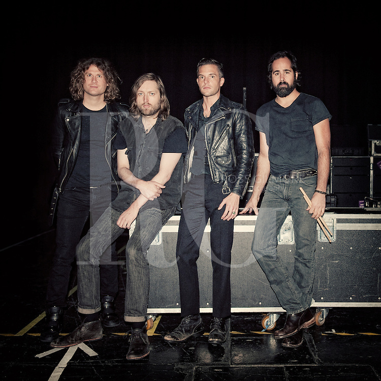 GLASGOW, UNITED KINGDOM - OCTOBER 26th:  The Killers pose back stage at the SEEC on October 26th , 2012 in Glasgow, United Kingdom. (Photo by Ross Gilmore/IPC Media/NME)