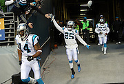 Carolina Panthers cornerback Bene' Benwikere (25) high fives a fan as he comes out of the tunnel for the NFL week 19 NFC Divisional Playoff football game against the Seattle Seahawks on Saturday, Jan. 10, 2015 in Seattle. The Seahawks won the game 31-17. ©Paul Anthony Spinelli