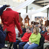 RAY VAN DUSEN/BUY AT PHOTOS.MONROECOUNTYJOURNAL.COM<br /> Stevens Auction Company employee Frank Blanchard holds a red beaded jacket once owned by the late R&B diva, Whitney Houston during the New Year's Extravaganza Auction Jan. 7 in Aberdeen. The jacket, which sold for $1,300, was included with three dresses worn by Houston. A man from London had previously placed winning bids on the items but was unable to fulfill his obligations.