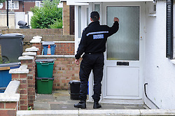 © Licensed to London News Pictures. 07/08/2012 . Police officers searching door to door, gardens,  and garages in the New Addington area in the hunt for missing Tia Sharp. 12 year old Tia Sharp has been missing from the Lindens on The Fieldway Estate in New Addington since Friday last week. .Photo credit : Grant Falvey/LNP