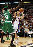 Jan. 28, 2011; Phoenix, AZ, USA; Phoenix Suns guard Goran Dragic (2) handles the ball against the Boston Celtics guard Marquis Daniels (8) at the US Airways Center. The Suns defeated the Celtics 88-71. Mandatory Credit: Jennifer Stewart-US PRESSWIRE