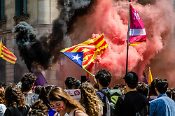 April 26, 2018 - Barcelona, Spain - At the end of the demonstration, black and red smoke was seen among the demonstrators with independence flags. Thousands of Catalan university students have demonstrated in the streets of Barcelona against repression and to protest the high price of university fees (Credit Image: © Paco Freire/SOPA Images via ZUMA Wire)