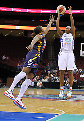 June 3, 2012; Newark, NJ, USA; New York Liberty guard Cappie Pondexter (23) shoots the ball while being defended by Indiana Fever forward Tamika Catchings (24) during the first half at the Prudential Center.