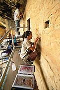 350405-1019 ~ Copyright: George H. H. Huey ~ Graduate student archaeologists from the University of Pennsylvania stabilizing original Anasazi plaster. Spruce Tree House, Mesa Verde National Park, Colorado.