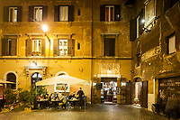 ROME, ITALY - 20 MARCH 2017: Old yellow sodium street lights, that have not been yet subsituted by white LED lights, illuminate the Parione neighborhood near Campo de' Fiori in the historical center of Rome, Italy, on March 20th 2017.<br /> <br /> Rome is undergoing a city-wide plan to change its public illumination from the current yellow sodium street lights CK to white LED lamps. In making the change, Rome joins a long line of cities around the world that have switched to the cheaper, and more environmentally friendly LED lighting, and it is not the first city where that change has come at the price of protest.<br /> <br /> Since July, some 100,000 led lights have already been installed, just over half the number that will be substituted in the 53 million euro changeover that is expected to save the city millions of euros in electrical bills. But when Rome's municipal electrical utility ACEA began to substitute the lamps in Rome's historic center, residents began to take note.
