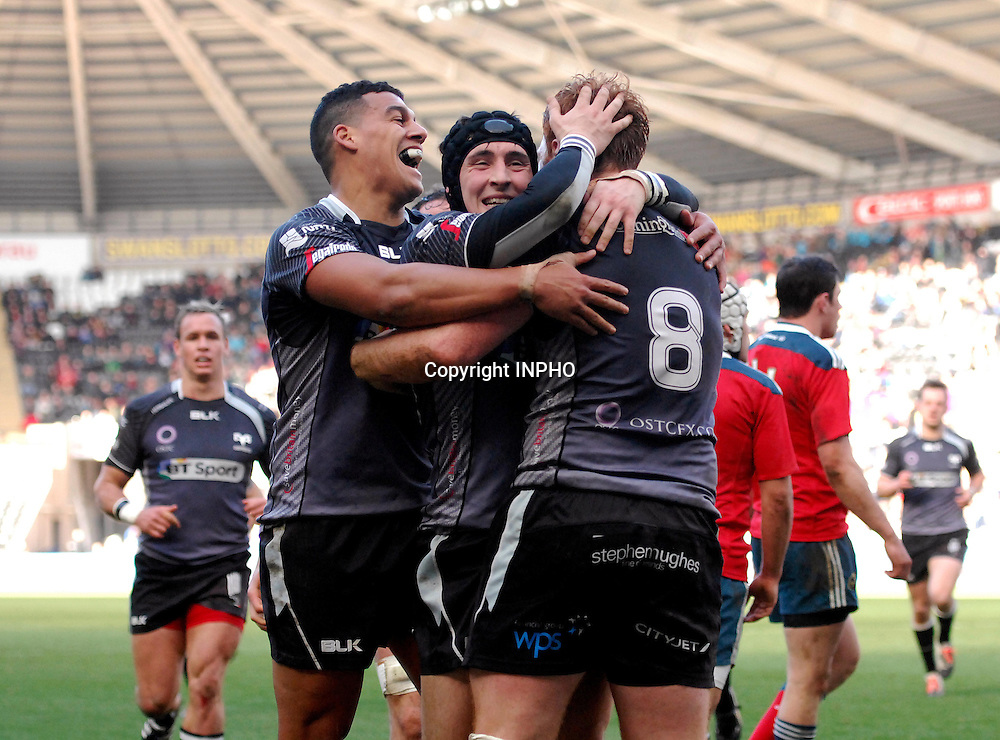 Guinness PRO12,  Liberty Stadium, Wales 7/3/2015<br /> Ospreys vs Munster<br /> Ospreys' Dan Baker celebrates his try with teammates<br /> Mandatory Credit &copy;INPHO/Ashley Crowden