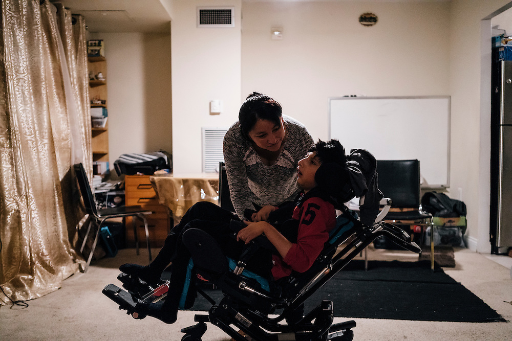 Eufronia Alba readies her son, Joshua, 10, for school at her apartment in Arlington, Va. on Dec. 15, 2016. Alba and her husband, undocumented Bolivians, were in deportation proceedings but have requested cancellation of removal because Joshua, who is American-born, has cerebal palsy and depends on his parents for everything including bathing and feeding. CREDIT: Greg Kahn / GRAIN for the Wall Street Journal TRUMPLOOP
