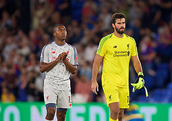LONDON, ENGLAND - Monday, August 20, 2018: Liverpool's Daniel Sturridge and goalkeeper Alisson Becker after the FA Premier League match between Crystal Palace and Liverpool FC at Selhurst Park. Liverpool won 2-0.(Pic by David Rawcliffe/Propaganda)