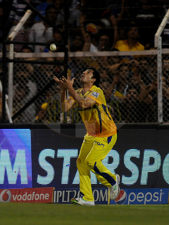 Mohit Sharma of The Chennai Superkings takes a catch to get the wicket of Kieron Pollard of the Mumbai Indians during the eliminator match of the Pepsi Indian Premier League Season 2014 between the Chennai Superkings and the Mumbai Indians held at the Brabourne Stadium, Mumbai, India on the 28th May  2014<br /> <br /> Photo by Pal PIllai / IPL / SPORTZPICS<br /> <br /> <br /> <br /> Image use subject to terms and conditions which can be found here:  http://sportzpics.photoshelter.com/gallery/Pepsi-IPL-Image-terms-and-conditions/G00004VW1IVJ.gB0/C0000TScjhBM6ikg