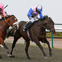 Forceful Appeal and Hayley Turner winning the 2.00 race