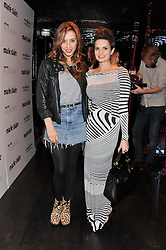 Left to right, ALEX GREWCOCK and JADE DAVIES from pop group Oh My! at a party to celebrate the launch of the Marie Claire Runway Magazine held at Le Baron a The Embassy, Old Burlington Street, London on 1st February 2012.