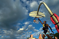 Giant Glass player #14 Charles Mason dunks a ball during the finals of the Sam Adams Summer League in Portsmouth, NH.