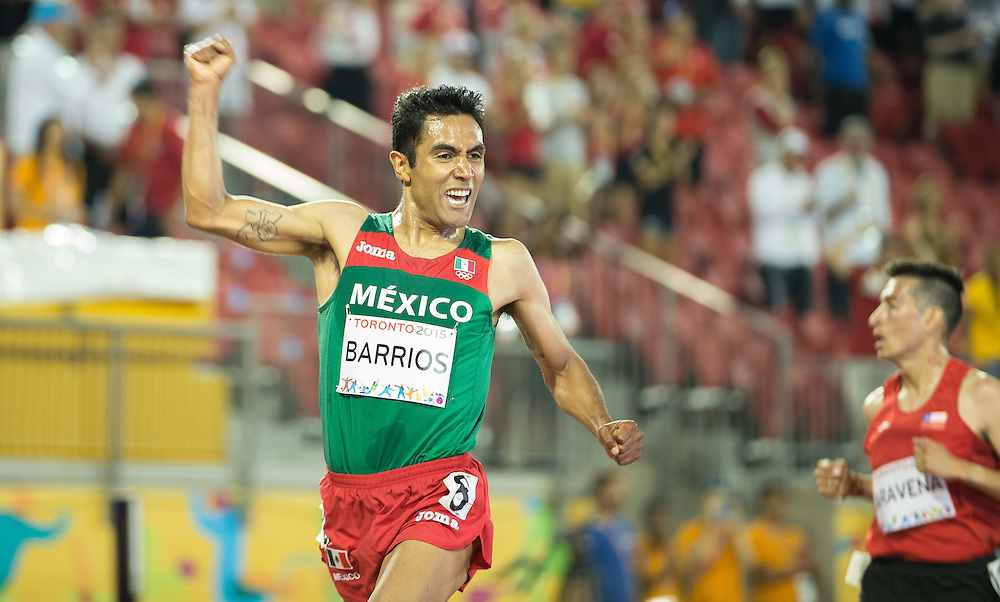 Juan Luis Barrios of Mexico celebrates his gold medal win in the men's 5000 metres at the 2015 Pan American Games at CIBC Athletics Stadium in Toronto, Canada, July 25,  2015.  AFP PHOTO/GEOFF ROBINS