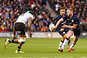Slick back pass from Finn Russell during the 2018 Autumn Test match between Scotland and Fiji at Murrayfield, Edinburgh, Scotland on 10 November 2018.