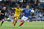 Oxford United Defender, Jamie Hanson (6) and Portsmouth Midfielder, David Wheeler (22) challenge for the ball during the EFL Sky Bet League 1 match between Portsmouth and Oxford United at Fratton Park, Portsmouth, England on 18 August 2018.