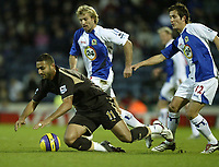 Photo: Aidan Ellis.<br /> Blackburn Rovers v Tottenham Hotspur. The Barclays Premiership. 19/11/2006.<br /> Spurs Mido is brought down by Blackburn's Michael Gray and Morten Gamst Pedersen