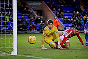 Peterborough Utd goalkeeper Conor O'Malley (25) is relieved to see this shot by Charlton forward Karlan Ahearne-Grant (18) go just wide during the EFL Sky Bet League 1 match between Peterborough United and Charlton Athletic at London Road, Peterborough, England on 26 January 2019.