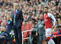 Football - 2017 / 2018 Premier League - Arsenal vs. Brighton & Hove Albion<br /> <br /> Arsenal Manager Arsene Wenger with Olivier Giroud at The Emirates.<br /> <br /> COLORSPORT/ANDREW COWIE