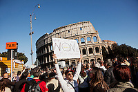 """ROME, ITALY - 21 APRIL 2013: A Supporter of the Five-Star Movement shows a banner saying """"Napolitano is not my Preident"""", in front of the Colosseum for  a rally the day after the re-election of President Giorgio Napolitano,  in Rome, Italy, on April 21, 2013.<br /> <br /> Italy's lawmakers re-elected 87-year-old President Giorgio Napolitano on Saturday in a bid to break the country's political gridlock, as protestors outside parliament protested agains the result. Giorgio Napolitano won with a  majority of 738 ballots out of 1,007 possible votes, ahead of leftist academic Stefano Rodota, backed by the the anti-establishment Five Star Movement, who scored 217."""