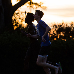 Runners compete on the track in the 800 meter run as the sunsets during a all comers track event sponsored by the New Orleans Club held at St Martin's Episcopal  in Metairie, La. Friday, July 7, 2017.