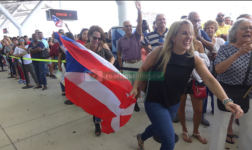 October 3, 2017 - Fort Lauderdale, Florida, U.S. - Families of Caribbean hurricane evacuees who arrived on board the Royal Caribbean Adventure of the Seas, rush to greet their relatives, Tuesday, at Port Everglades. More than 3,000 people from Puerto Rico and the U.S. Virgin Islands were brought to Florida on board the Royal Caribbean Adventure of the Seas.  (Credit Image: © Joe Cavaretta/TNS via ZUMA Wire)