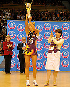 Laura Geitz holds the trophy aloft after it had been awarded by the Premier of Queensland ~ Netball action from ANZ Championship Grand Final - Queensland Firebirds v Northern Mystics - played at the Brisbane Convention Centre on Sunday 22nd May 2011 ~ Photo : Steven Hight (AURA Images) / Photosport