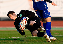 Goalkeeper of Olimpija Jan Oblak and Robert Kurez of Drava at 18th Round of PrvaLiga football match between NK Olimpija and NK Labod Drava, on November 21, 2009, in ZAK, Ljubljana, Slovenia. Olimpija defeated Drava 3:0. (Photo by Vid Ponikvar / Sportida)