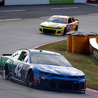 Kyle Larson (42) races through turn three to practice  for the First Data 500 at Martinsville Speedway in Martinsville, Virginia.