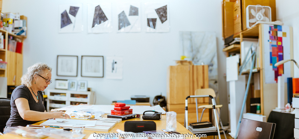 Artist in her studio. Silver street tenants.<br /> Photographed by editorial photographer Nathan Lindstrom.