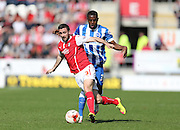 Danny Lafferty beats Mustapha Carayol, Brighton midfielder during the Sky Bet Championship match between Rotherham United and Brighton and Hove Albion at the New York Stadium, Rotherham, England on 6 April 2015.
