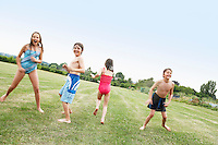 Boys and Girls in Swimsuits playing in field