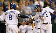 Kansas City Royals Mike Moustakas (8) is congratulated by Lorenzo Cain (6) after hitting a two run homerun off of Tampa Bay Rays pitcher Alex Cobb during the 6th inning of their baseball game at Kauffman Stadium in Kansas City, Mo., Tuesday, April 30, 2013.  (AP Photo/Colin E. Braley).