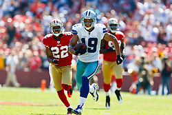 September 18, 2011; San Francisco, CA, USA; Dallas Cowboys wide receiver Miles Austin (19) rushes past San Francisco 49ers cornerback Carlos Rogers (22) after a pass reception to score a touchdown during the second quarter at Candlestick Park.