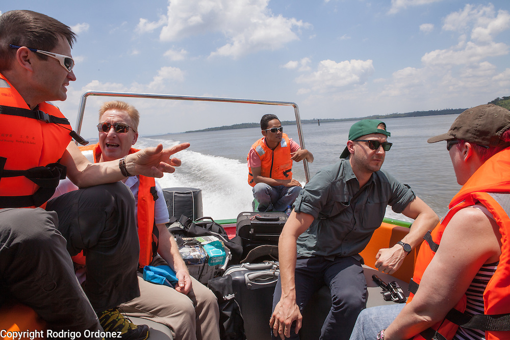 Visitors chat as they ride a speedboat near Balikpapan, East Kalimantan, Indonesia, on March 12, 2016. From left to right are Justin Adams, Global Managing Director for Lands at The Nature Conservancy; Robert Barker, Head of CSR and Sustainable Investment Client Solutions at BNP Paribas; Stephen Donofrio, Senior Advisor for Supply Change at Forest Trends Ecosystem Marketplace; and Fiona Wheatley, Sustainable Development Manager at Marks &amp; Spencer. <br /> (Photo: Rodrigo Ordonez)