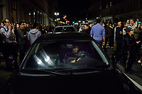 NOVEMBER 9, 2016 - OAKLAND, CA: A man decides to ride out the protest in his car after becoming trapped amongst the crowd at 14th Street and Broadway, in Oakland, California on November 9, 2016. (Photo by Philip Pacheco)