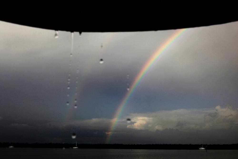 A rainbow appears after a summer storm rolled through the community of people living on their boats anchored in Estero Bay.