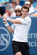 CINCINNATI, OH - AUGUST 22: Andy Murray of Great Britain returns a shot to Roger Federer of Switzerland during day six of the Western & Southern Financial Group Masters on August 22, 2009 at the Lindner Family Tennis Center in Cincinnati, Ohio. Federer defeated Murray 6-2, 7-6. (Photo by Joe Robbins)