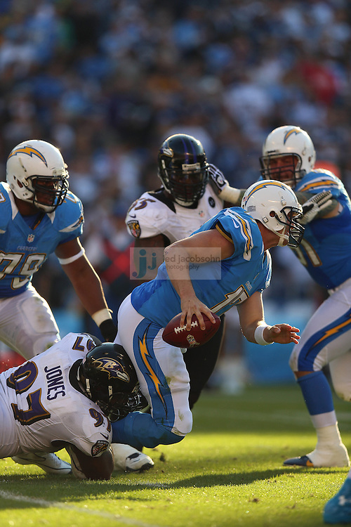San Diego Chargers quarterback Philip Rivers (17) is sacked by Baltimore Ravens defensive end Arthur Jones (97) during an NFL game on Sunday, November 25, 2012 in San Diego, CA.  (Photo by Jed Jacobsohn)