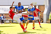 Charlton Athletic forward Josh Magennis (9) with a volley that goes high and wide during the EFL Sky Bet League 1 Play Off second leg match between Shrewsbury Town and Charlton Athletic at Greenhous Meadow, Shrewsbury, England on 13 May 2018. Picture by Simon Davies.