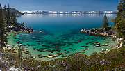 Ultra high-resolution panoramic image of Secret Cove at Lake Tahoe with snow covered mountains in the background.