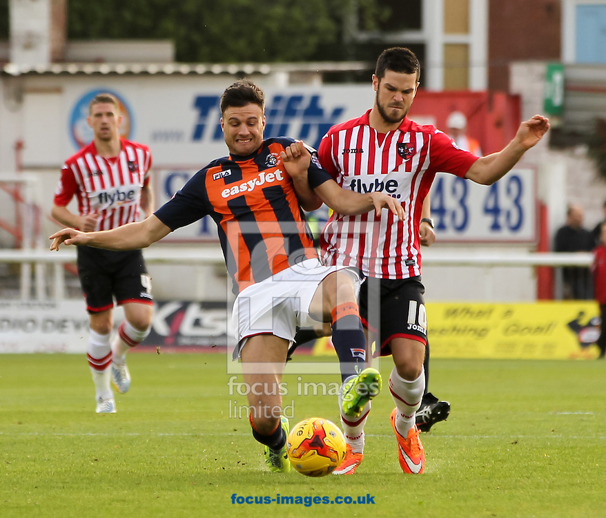 Jimmy Keohane (right) of Exeter City and Jonathan Smith (front left) of Luton Town battle for the ball during the Sky Bet League 2 match at St James' Park, Exeter<br /> Picture by Tom Smith/Focus Images Ltd 07545141164<br /> 01/11/2014